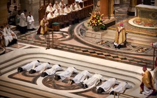 During the Mass of Ordination to the Priesthood the candidates lie in the well of the Cathedral's altar during the Litany of Supplication.  As the candidates prostrate themselves, all present in the Cathedral Basilica kneel and unite their voices with the Church universal in prayer for God's grace and mercy for those to be ordained.  The candidates are (l-r) Rev. Mr. James Andrew Holbrook, Rev. Mr. Craig Thomas Holway, Rev. Mrs. Joseph Xiu Hui Jiang, Rev. Mr. Timothy James Noelker, Rev. Mr. Anthony Bernard Ochoa, Rev. Mr. Jason Joseph Schumer, Rev. Mr. Nicklaus Ewald Winker, Rev. Mr. Anthony Richard Yates.  Archbishop Robert Carlson (front) and Bishop Robert Hermann (left) kneel in prayer with the candidates.