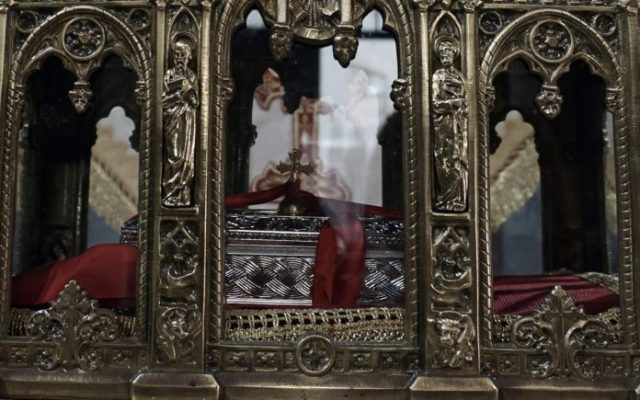 The presumed relics of the Saint Valentine are on display inside the Church of Metastasis of Virgin Mary in Mytilene on the island of Lesbos on February 12, 2017.   Valentine's Day celebrations organized by the island of Lesbos, which hosts the presumed relics of the martyr, sparked a new dispute between Christian Orthodox and Catholic churches, reported the Greek news agency Ana on February 12. / AFP PHOTO / STRINGER